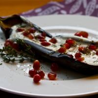 Aubergines with buttermilk sauce & pomegranate seeds